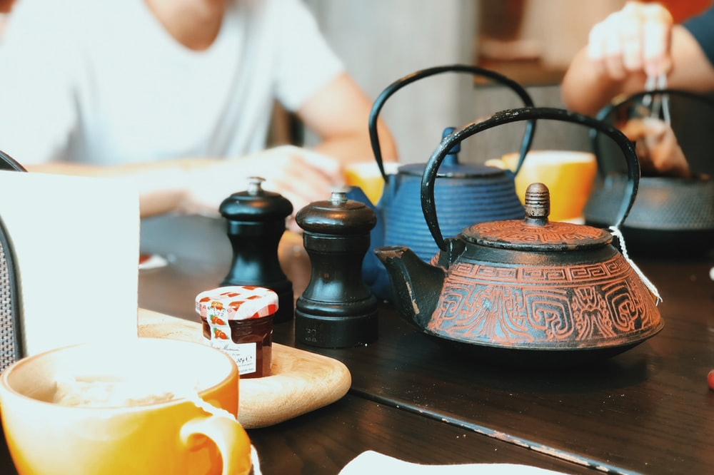 two teapots on table top