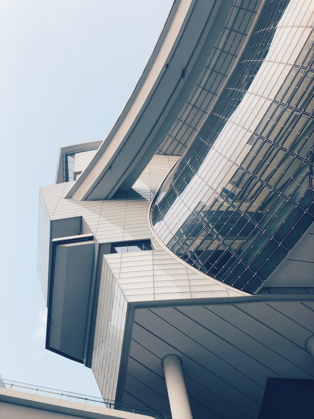 low-angle photograph of white concrete structure