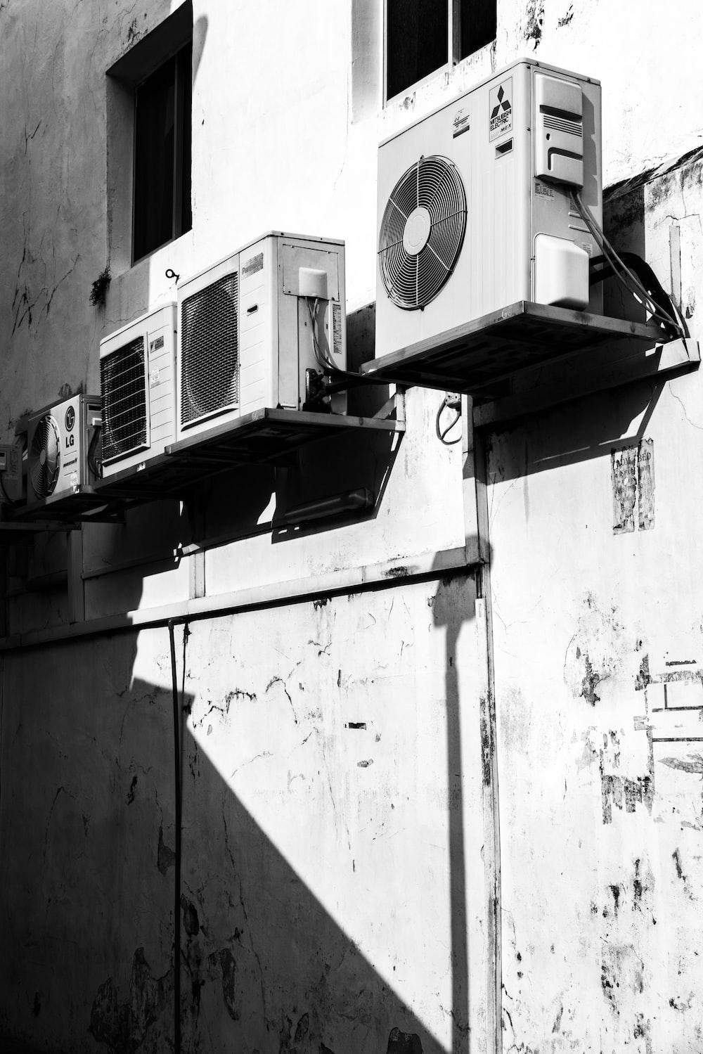 greyscale photography of AC units