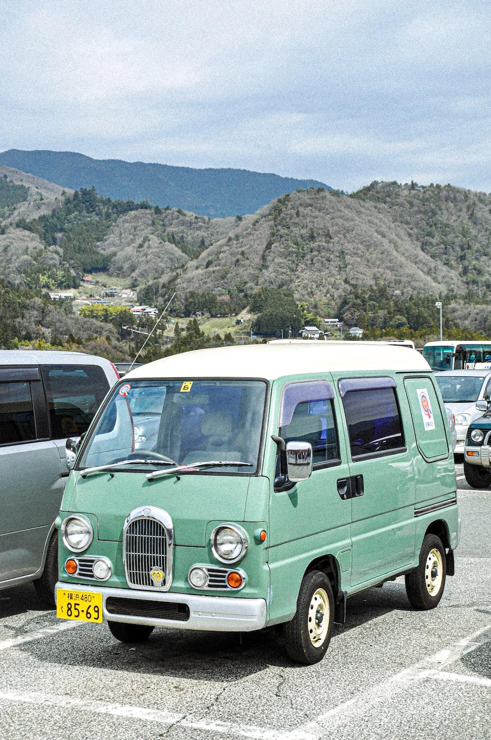 teal van parked on parking lot