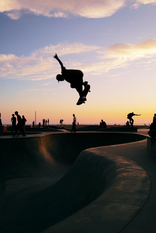 man in midair skateboarding