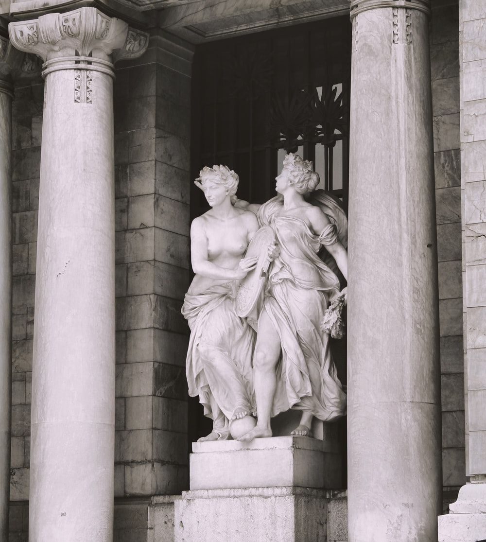 architectural photography of women statue