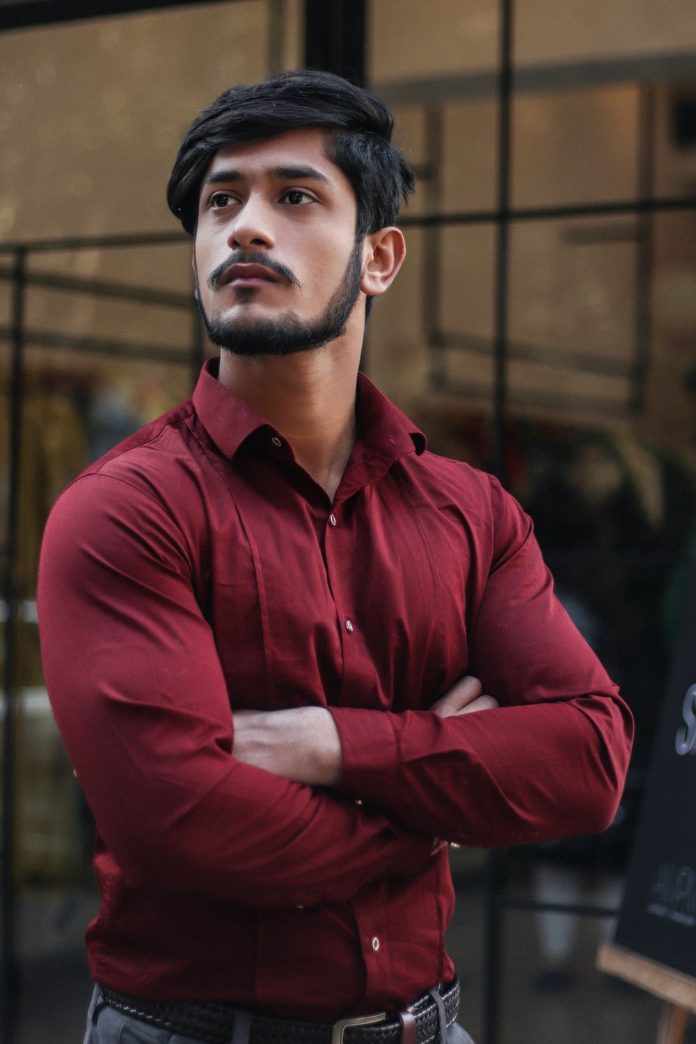 man in red button-up collared top