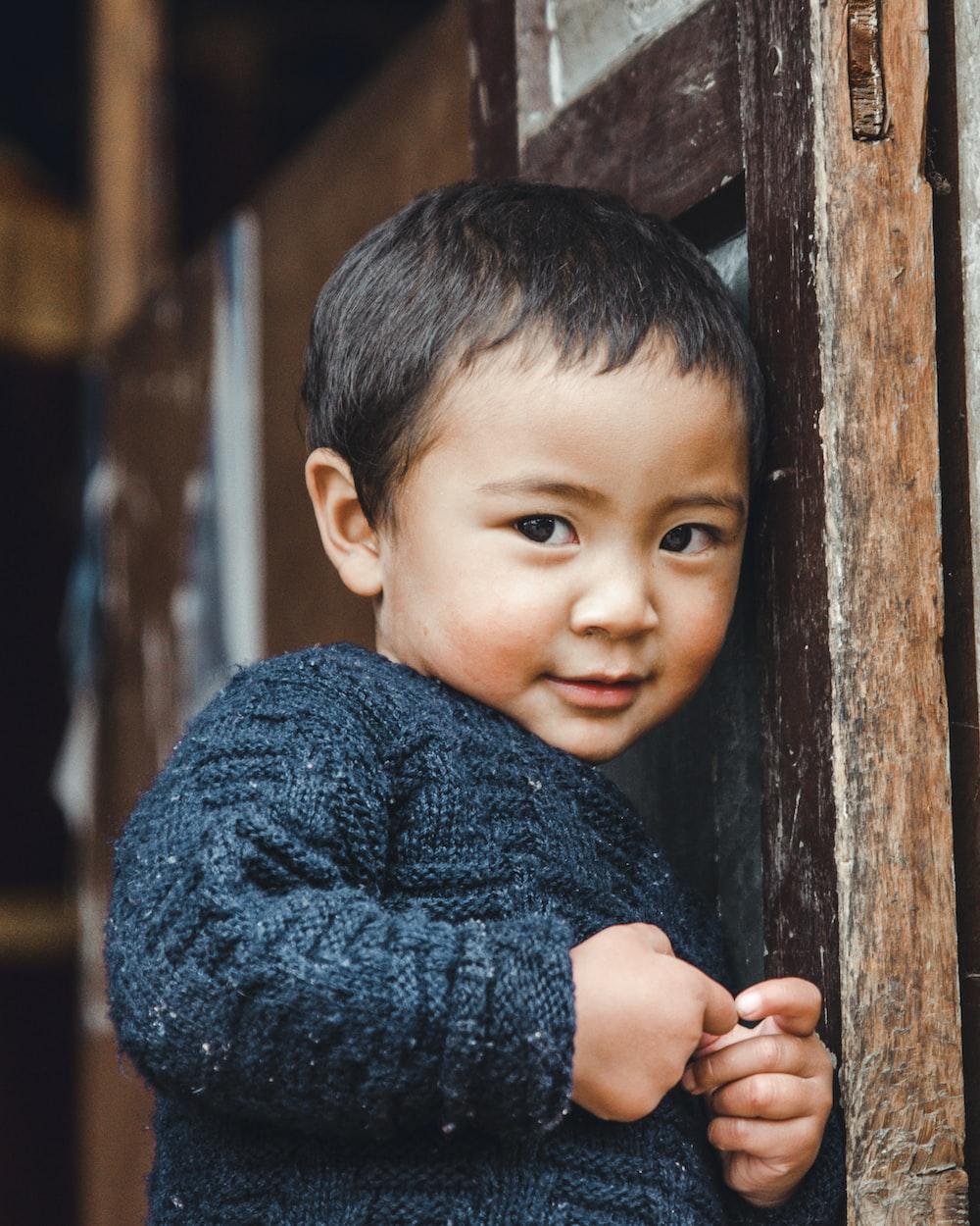 toddler in black sweater