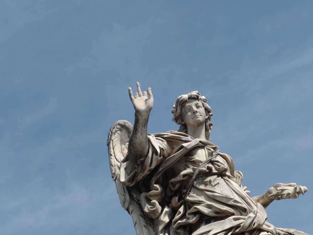 angel with right hand up statue