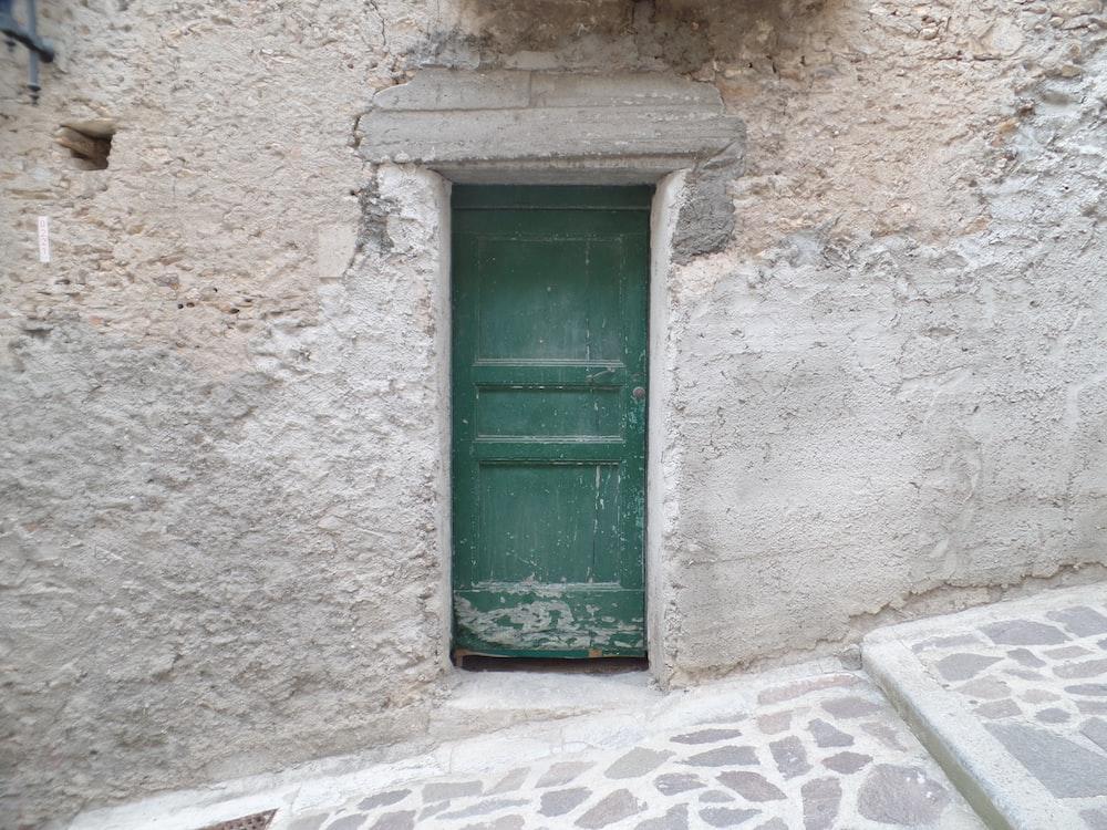 building with closed green door