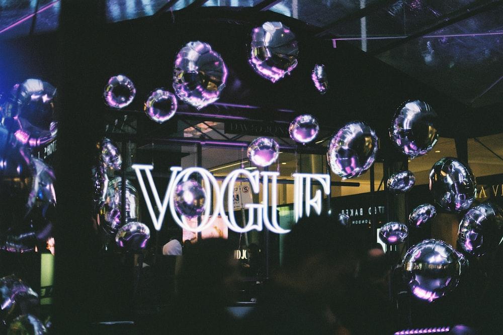 white Vogue neon signage photo