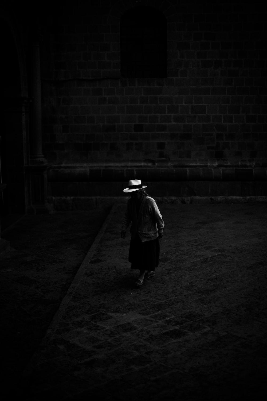 woman standing on the dark