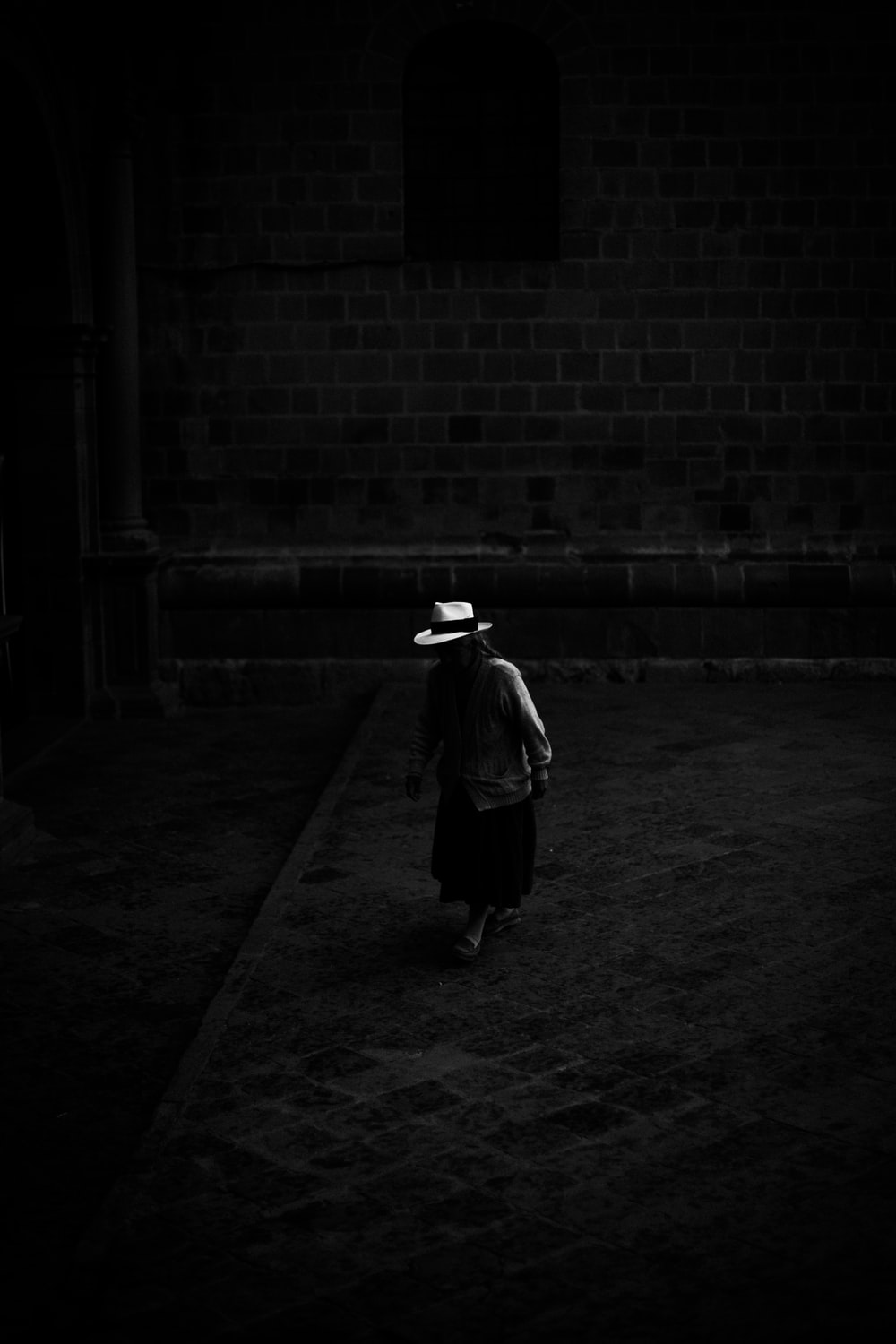 woman standing on the dark