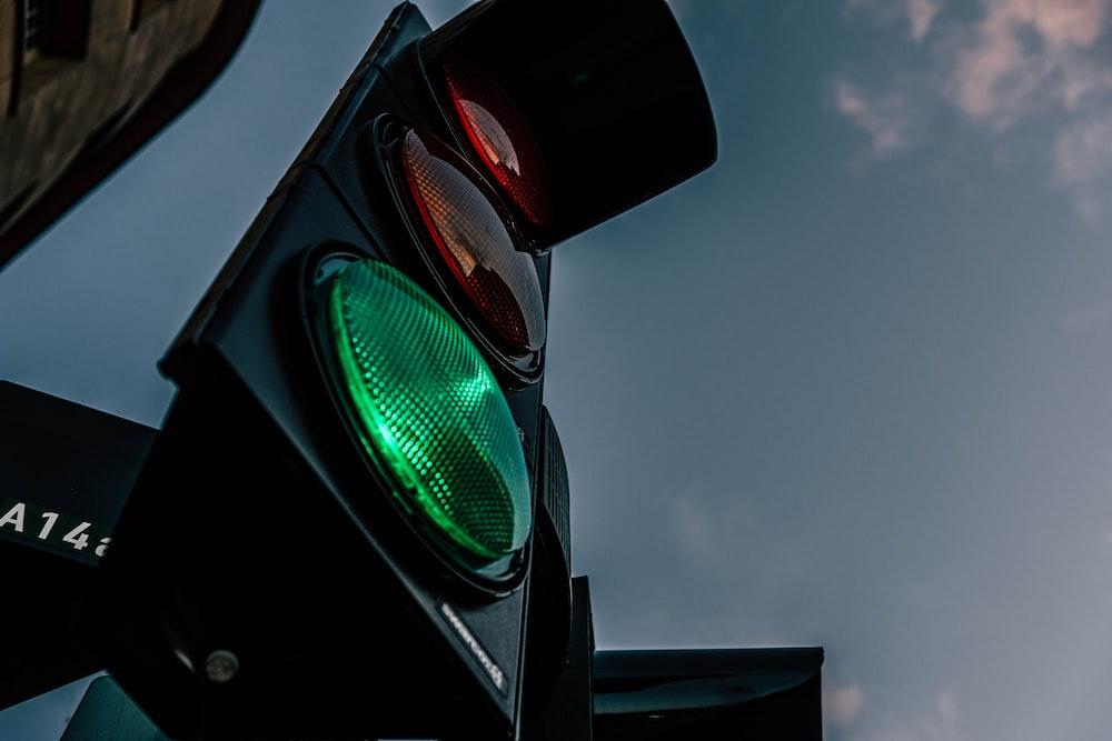 black traffic light under blue sky