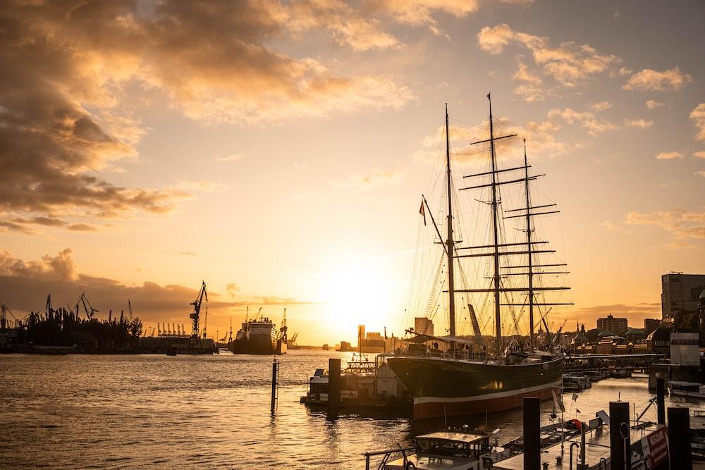 sailboat in dock during golden hour