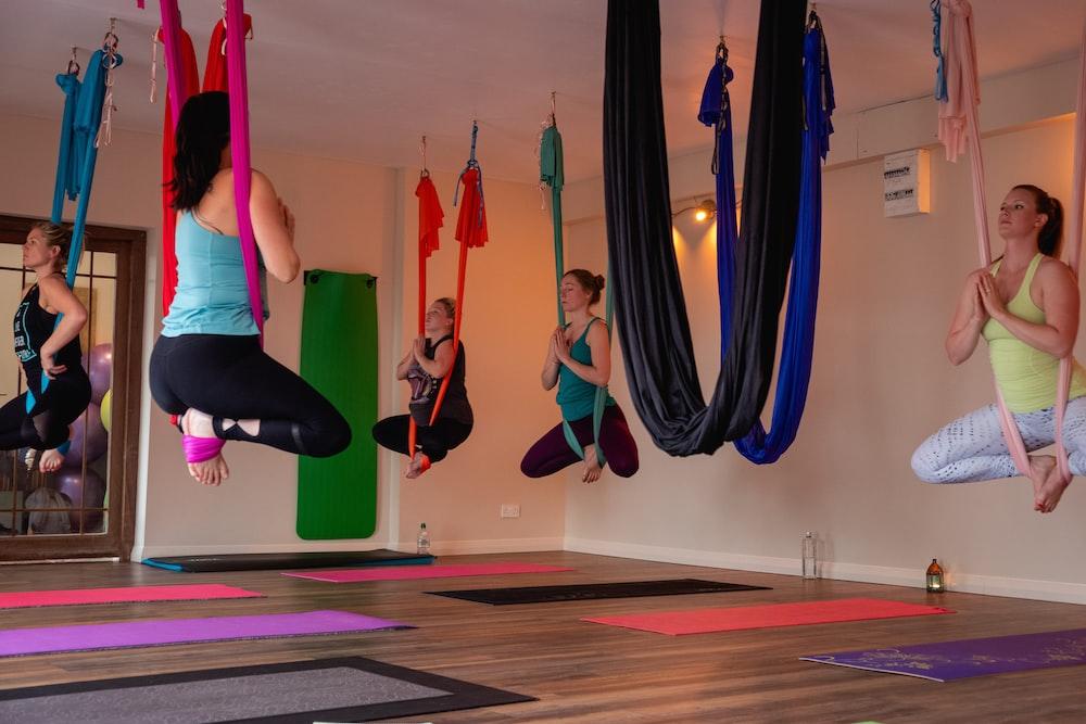 women doing yoga inside room