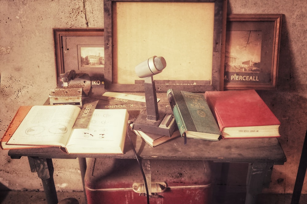 books and desk microphone on table