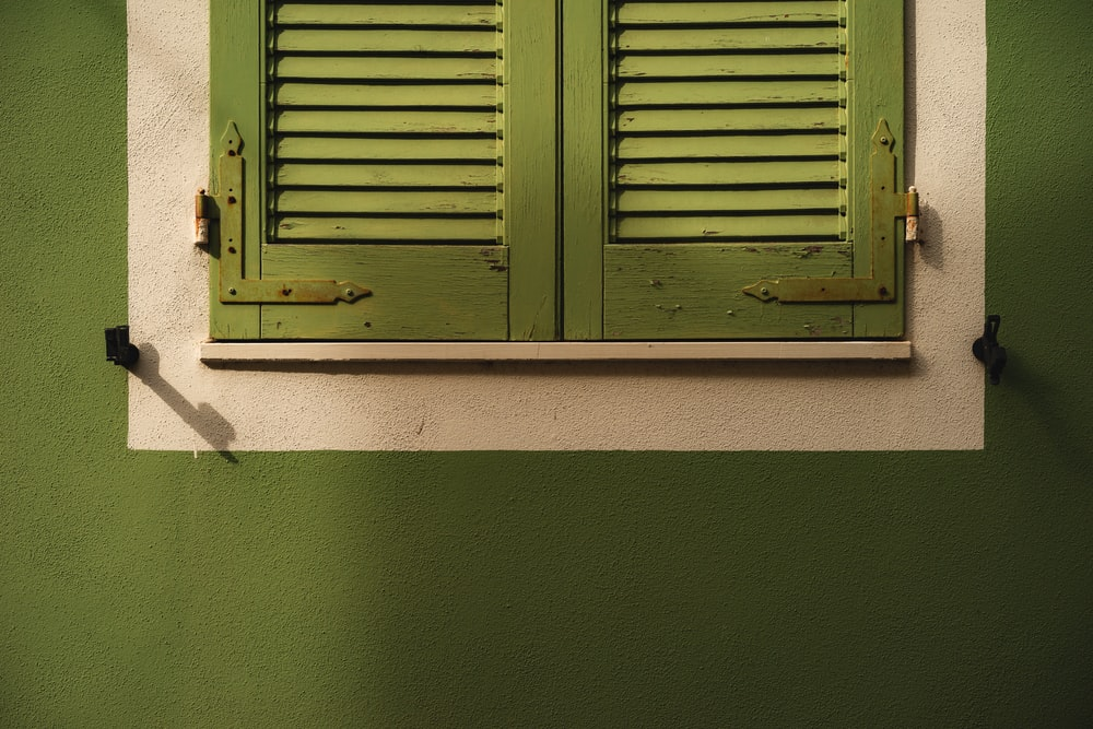closed green wooden door
