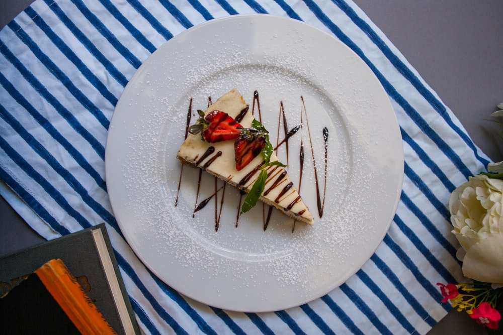 sliced cake in plate on table