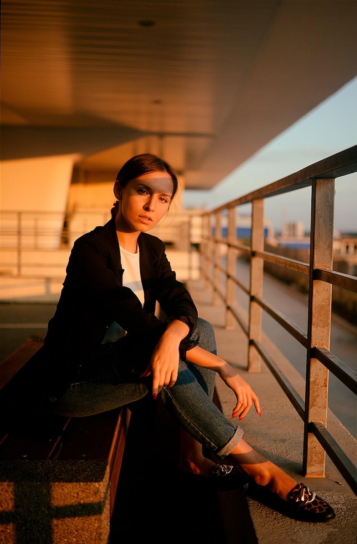 woman wears black cardigan