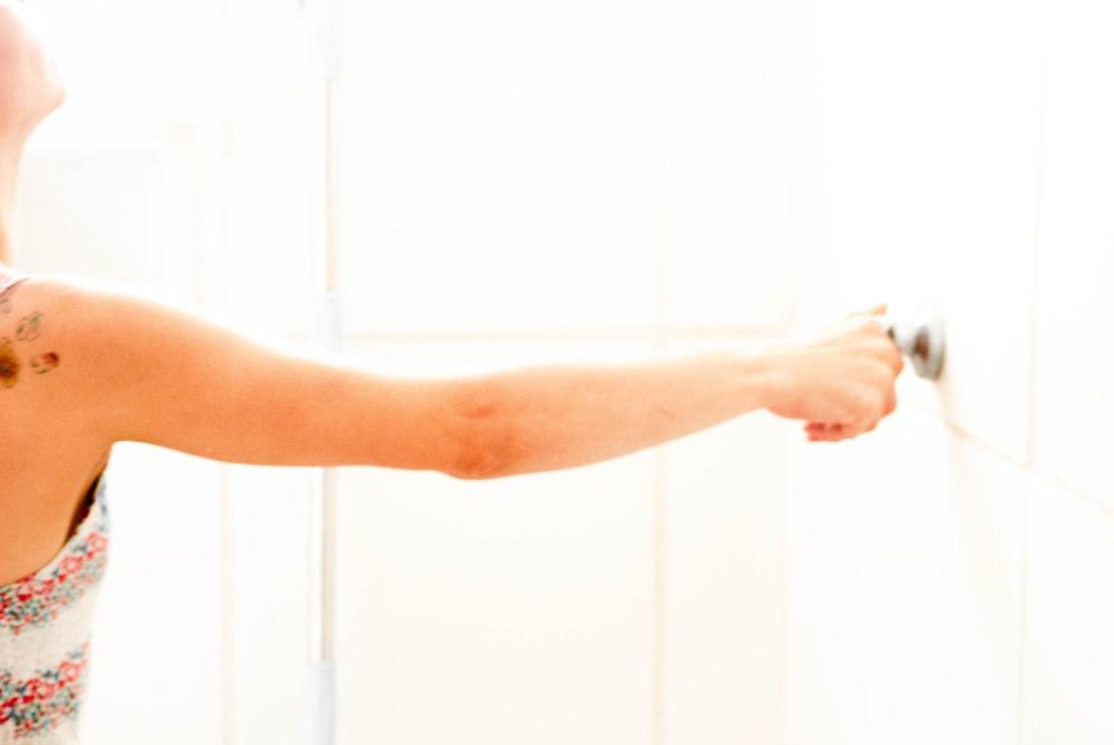 woman touching door knob