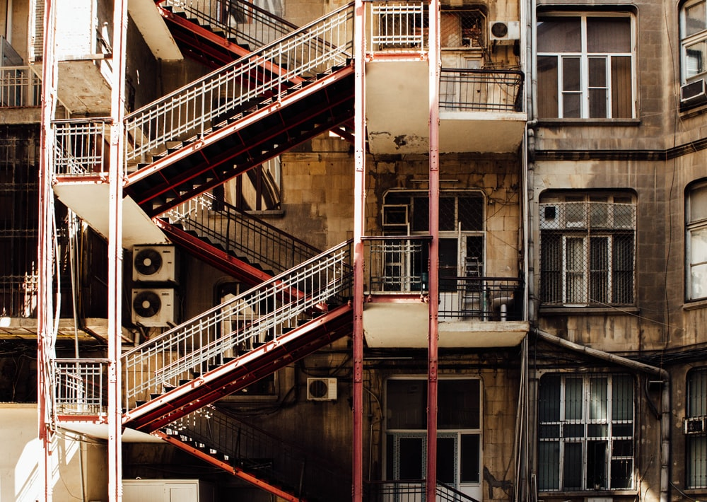 brown and gray building with stairs