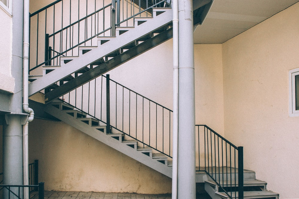 white concrete stairs outside building
