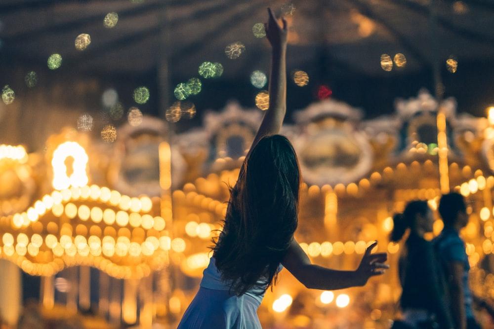 ballerina dancing by carousel
