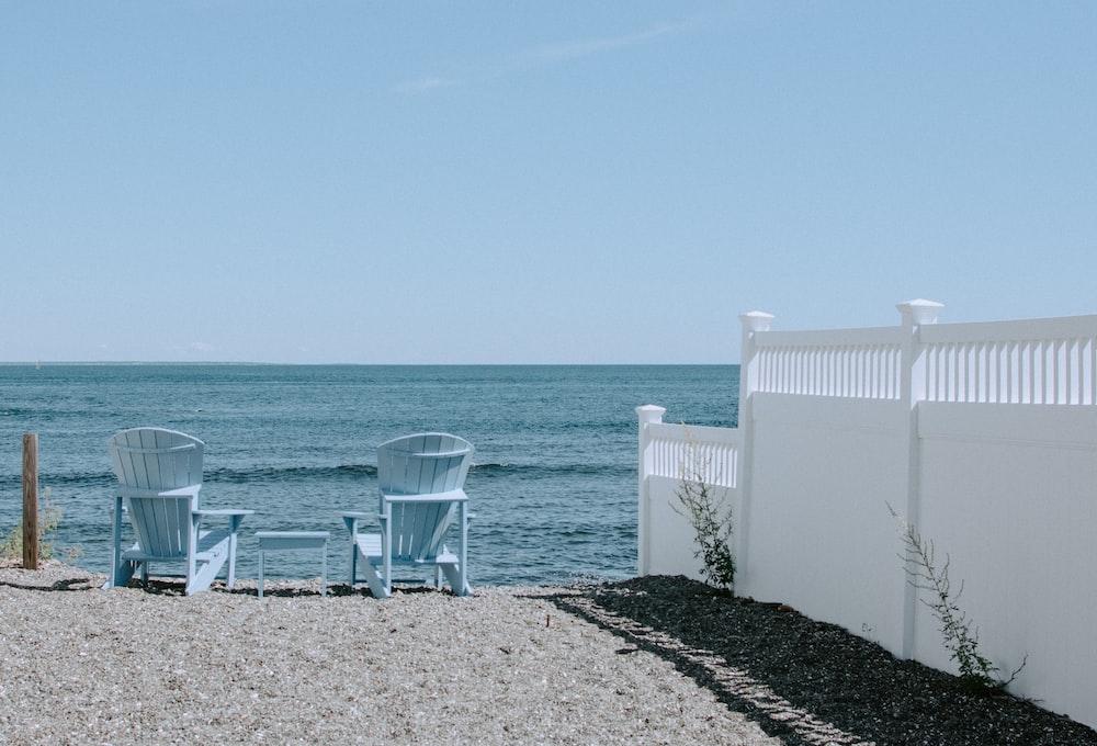 two Adirondack chairs in beach