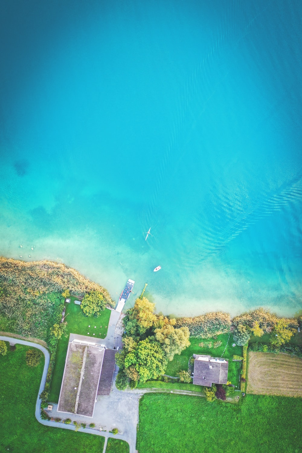 aerial photography of building beside body of water during daytime