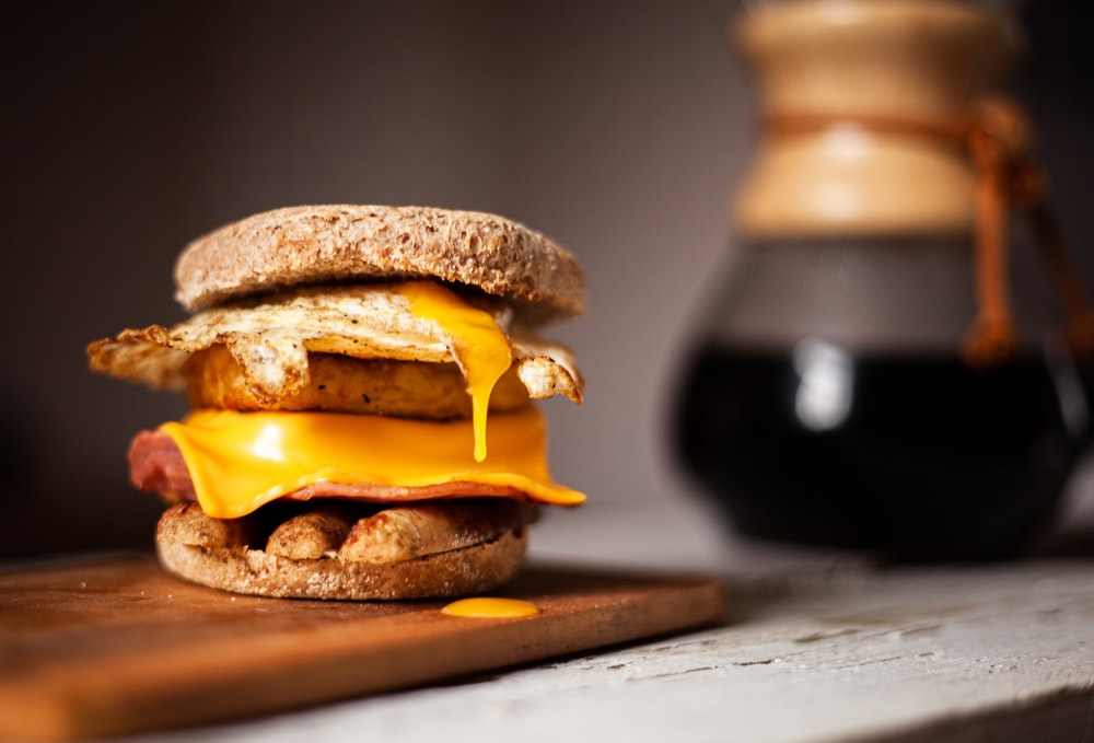 baked burger on wooden surface