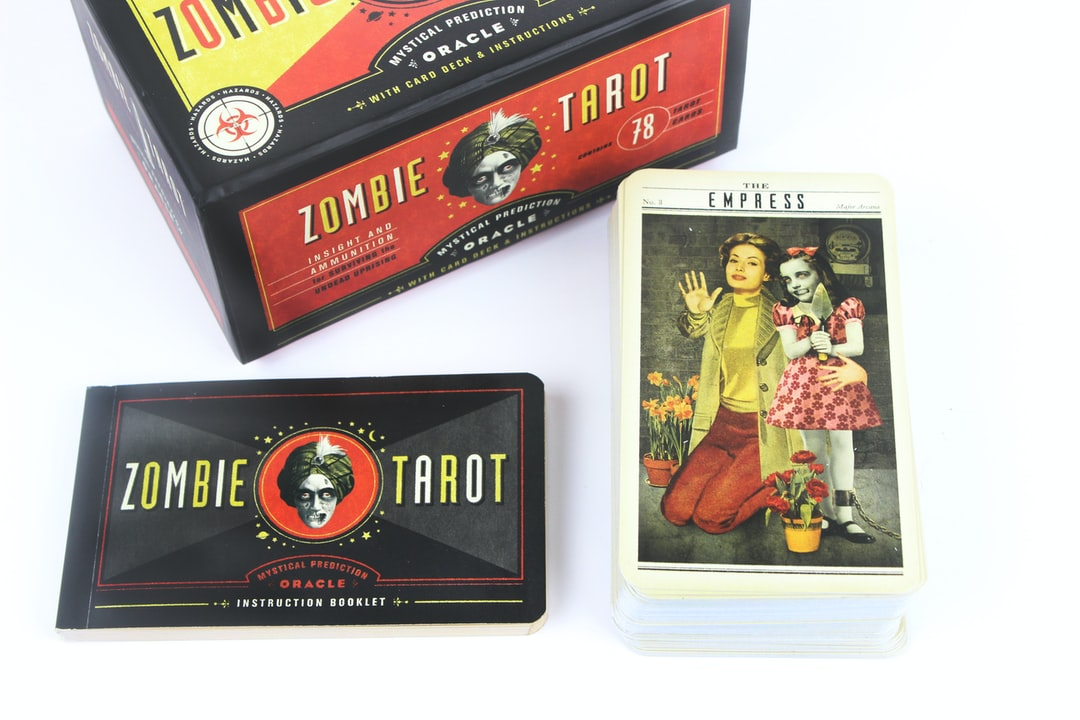 The Zombie Tarot boxed set of deck of cards, guidebook and more features cryptic drawings of the four arcana.