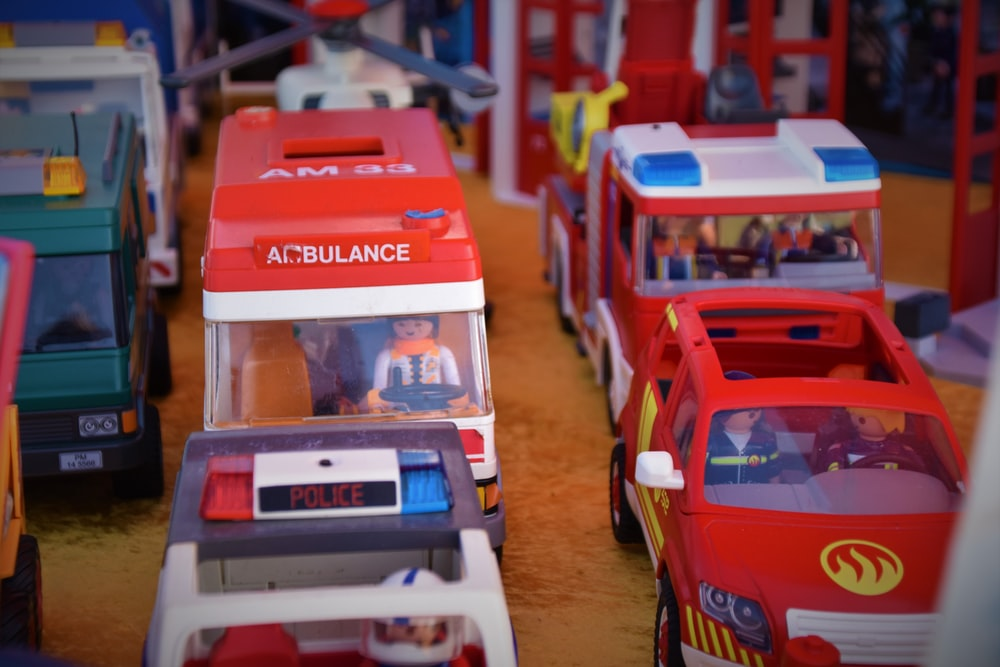 red and white car toy lot