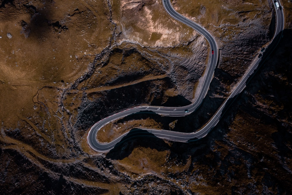 aerial photography of road on mountain during daytime