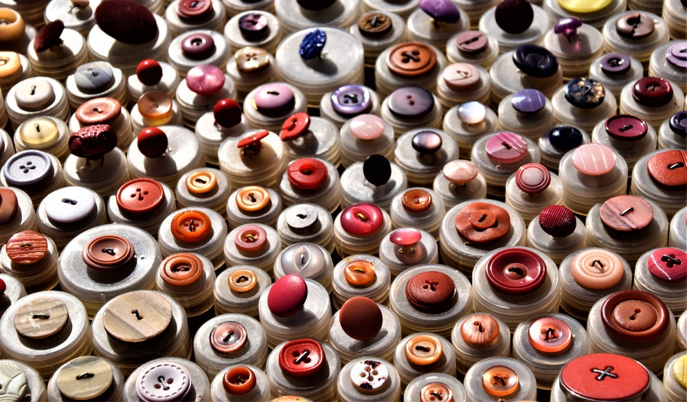 assorted-colored clothes buttons