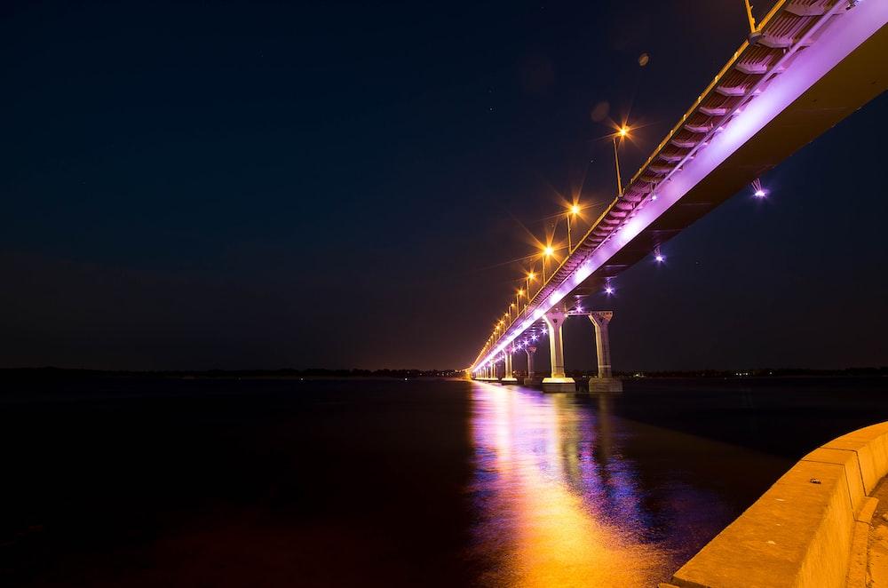 lighted bridge during night