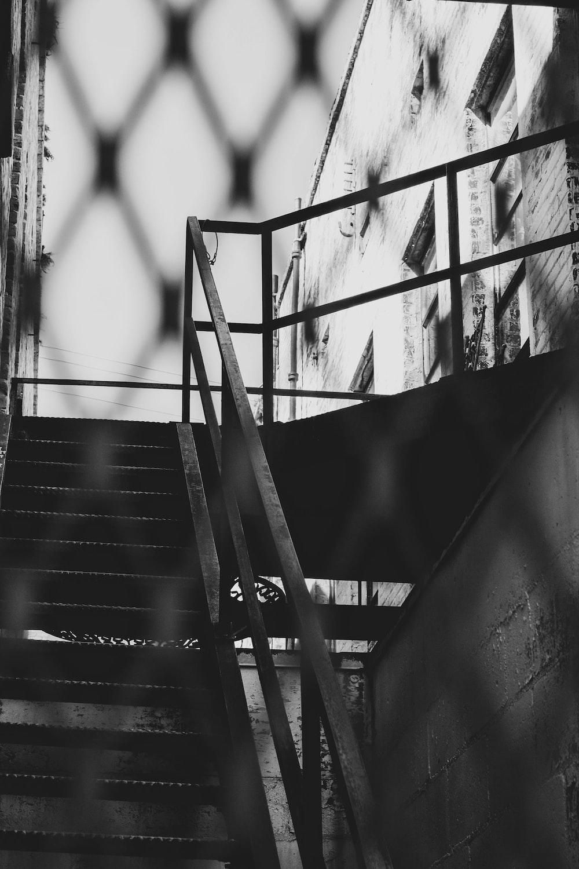 grayscale behind fense stair