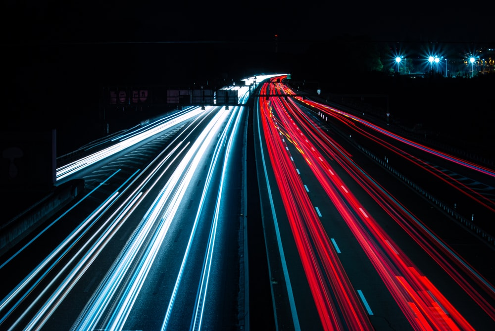time-lapse photography of vehicles on road at night