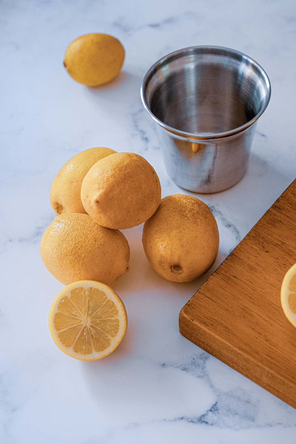 lemon fruits and gray stainless steel cup