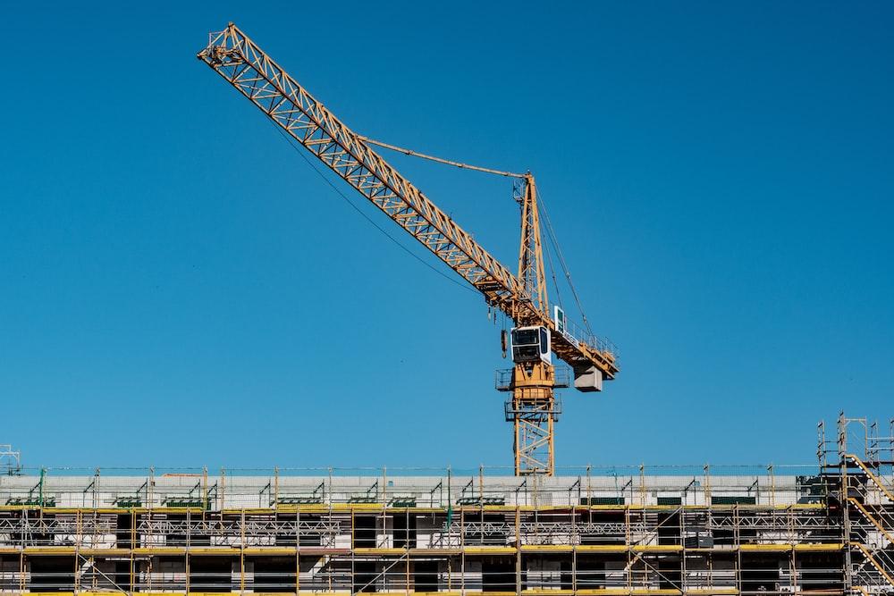 yellow building crane