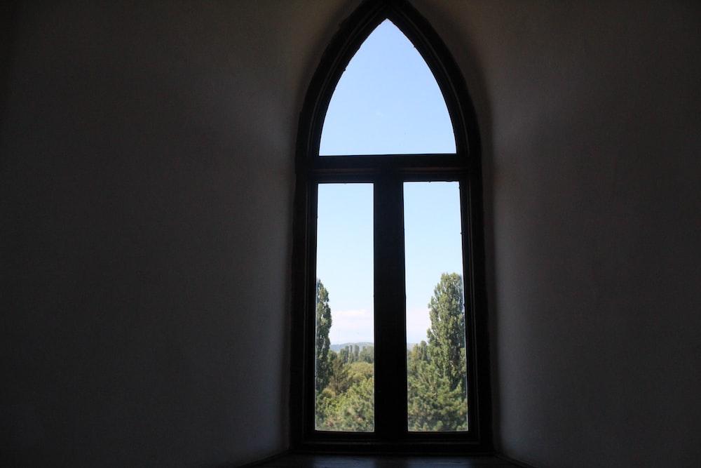 brown-framed 3-panel windowpane