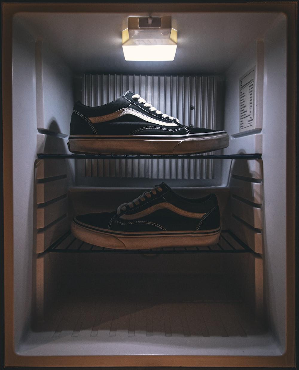 pair of black Vans low-top sneakers on rack