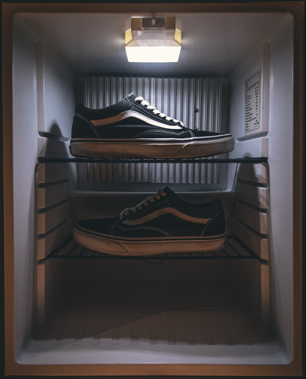 pair of black Vans low-top sneakers on rack