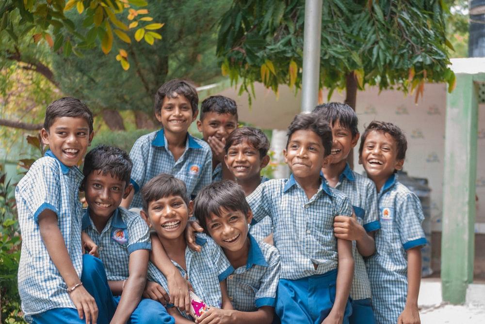 group of boys wearing blue school uniforms photo