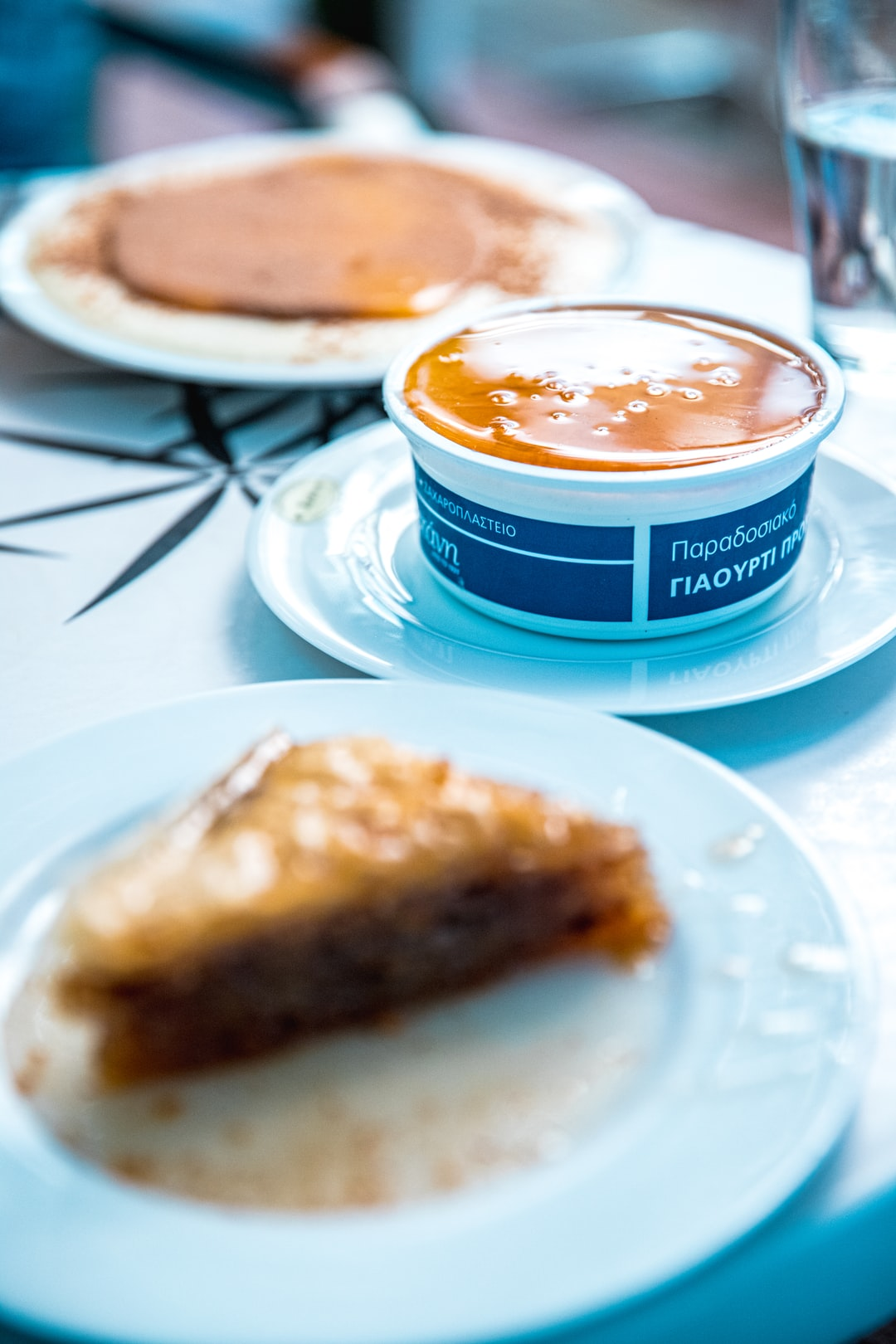 One of the best desserts I've ever had at a local coffee shop in Athens, Greece that has been open since the 1950's. Family owned. A traditional goat yogurt container with a thick layer of local made Greek honey on top and a side of fresh, local Greek Baklava just cause'.  Shot & Edited By @VisualsByRoyalZ