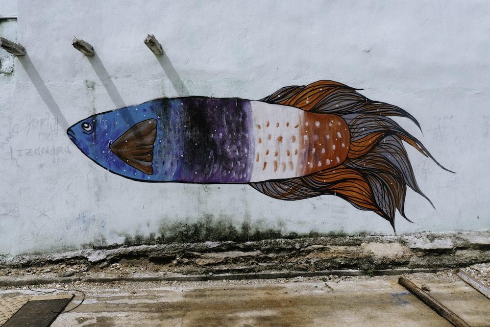 blue, purple, white, and orange fish wall art
