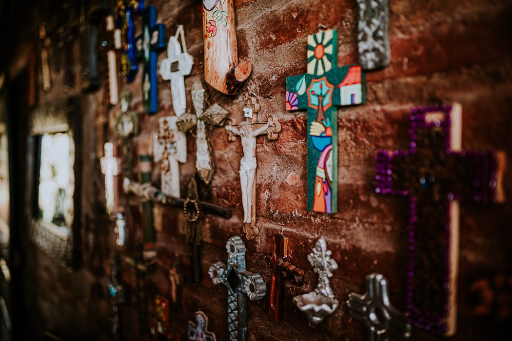 Wall of brightly colored and diverse small crosses
