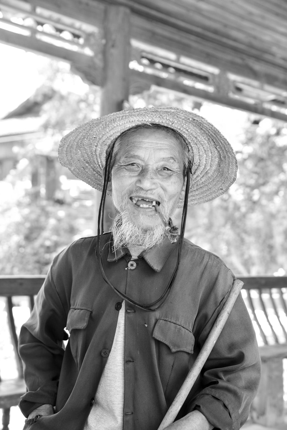 grayscale portrait photography of a smiling man