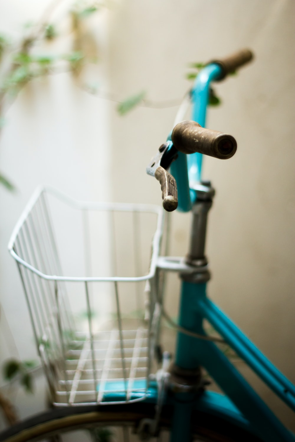 selective focus photography of blue bike