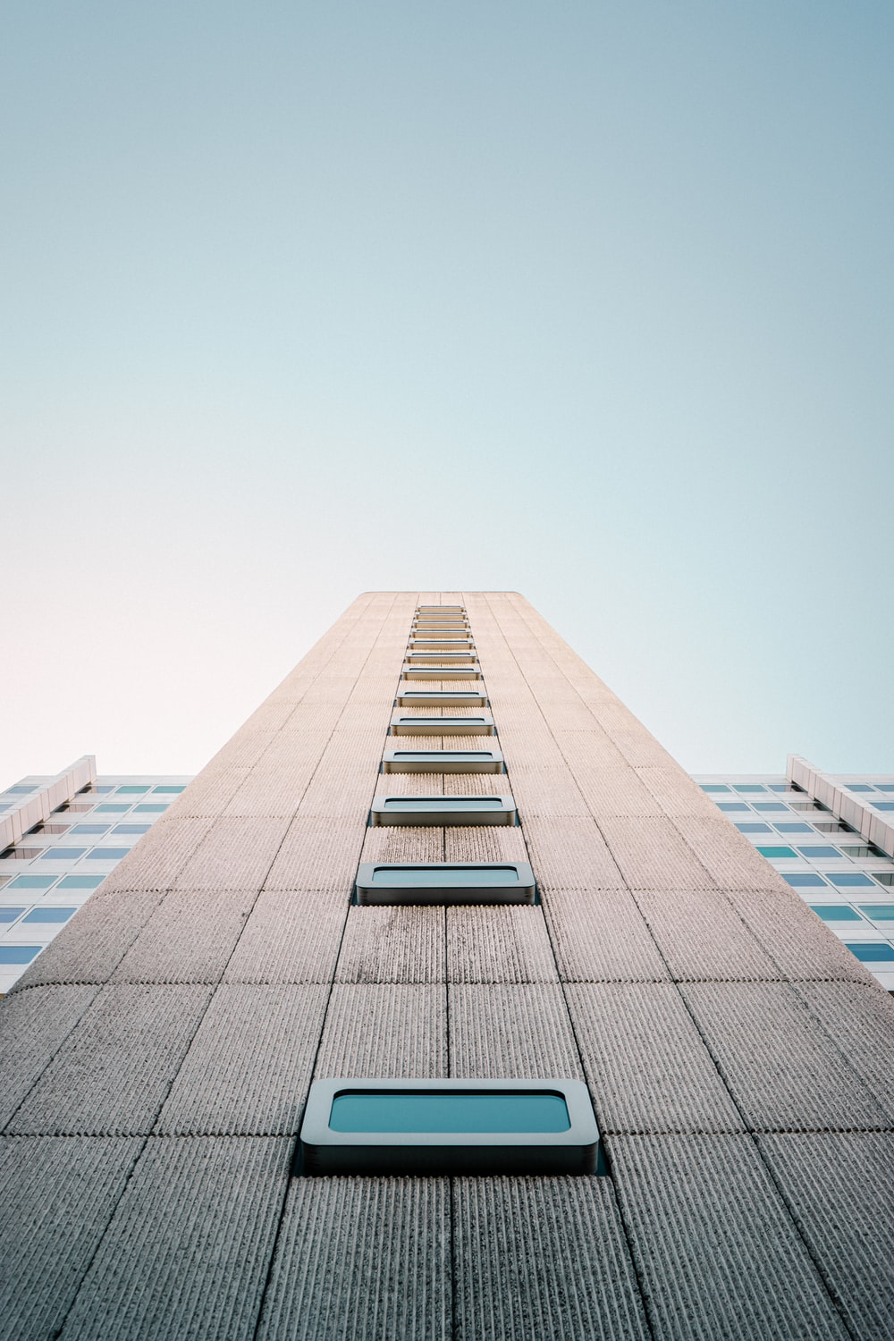 low angle photo of beige building
