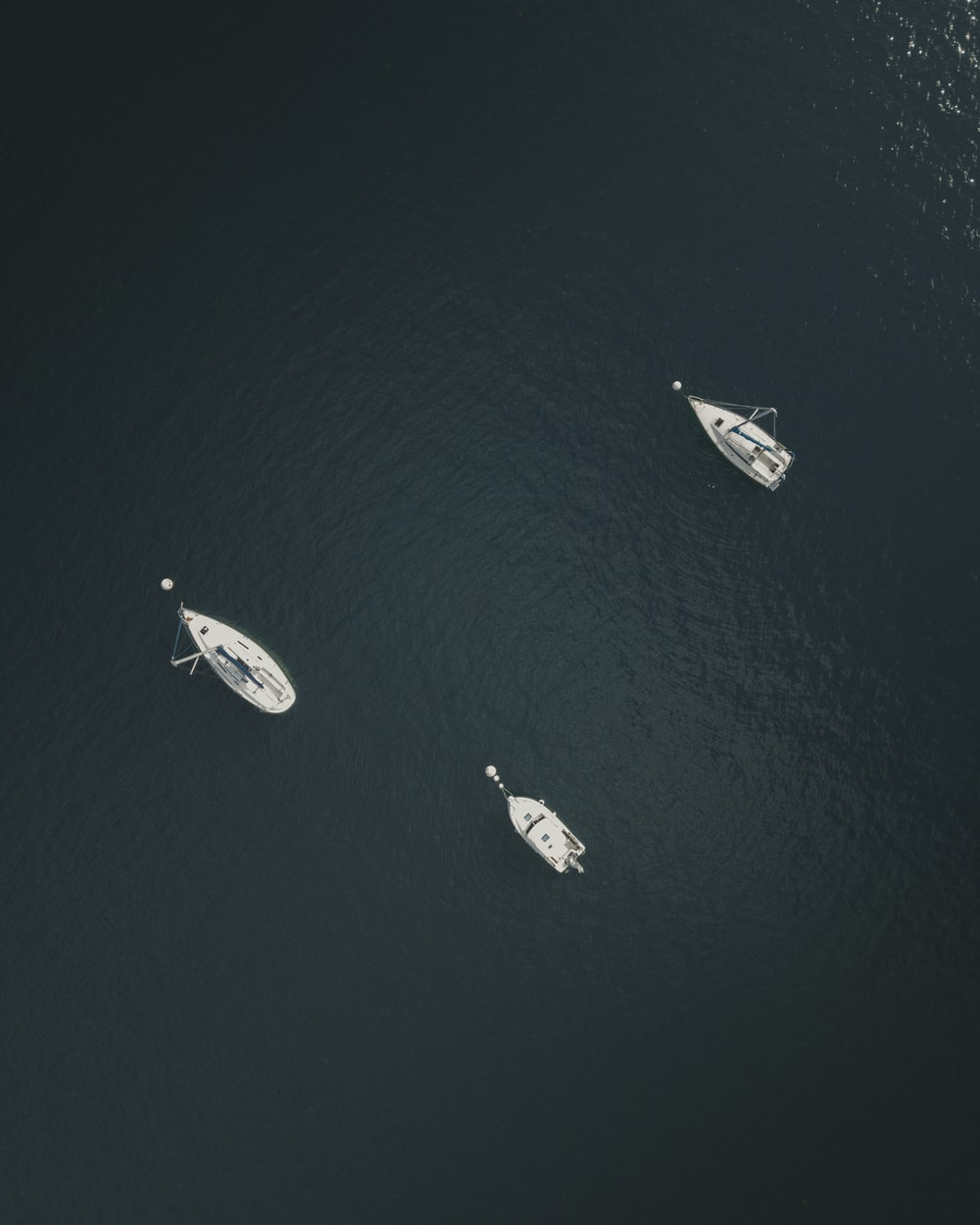 aerial view of three white sailboat