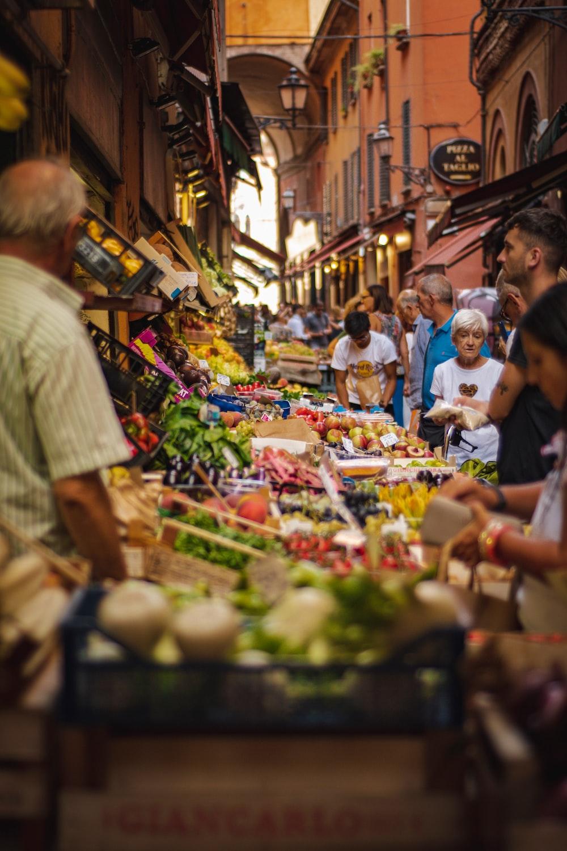 people looking at vegetables