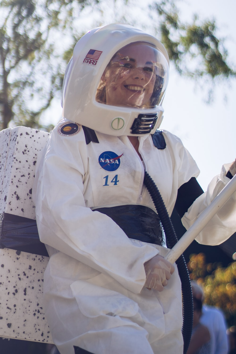 woman wearing a white and blue astronaut costume