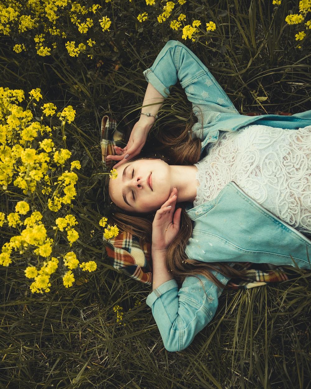 woman lying on grass field